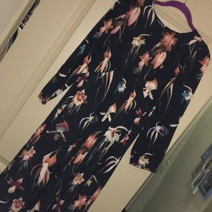 Long sleeve black midi dress with flower detail